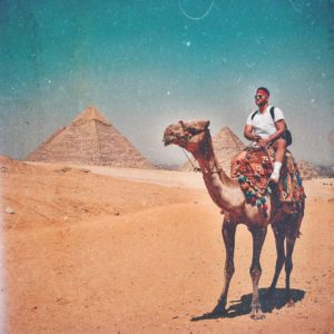Sherif Shaker riding a camel in Egypt