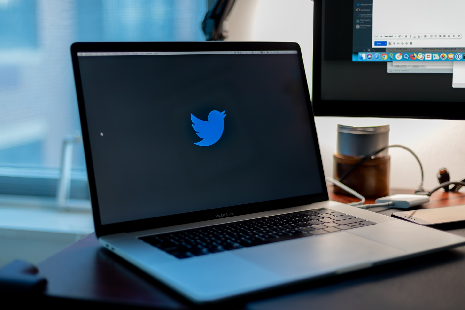 A laptop featuring Twitter's logo on the screen